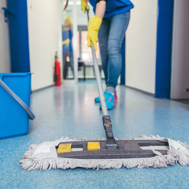 Person Dry Mopping Hallway