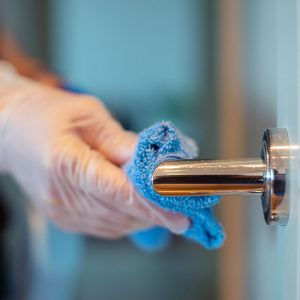 Person Cleaning Door Handle